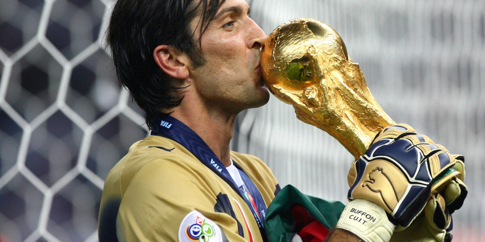 Gianluigi Buffon (ITA) celebrates with the trophy after the final of the 2006 FIFA World Cup between Italy and France. (Photo by Eddy LEMAISTRE/Corbis via Getty Images)